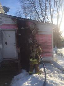 Firefighters overhauling to make sure fire did not spread inside the home