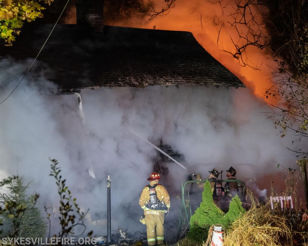Crews working on suppression with heavy fire to the second floor rear of the home  Photo by PIO Gary McGinnis