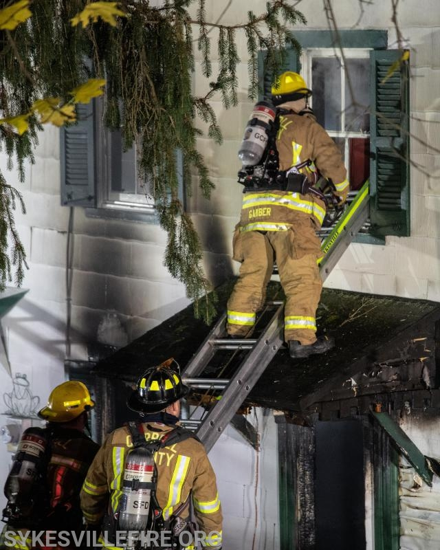 Crews preparing to enter the burned-out second floor  Photo by PIO Gary McGinnis