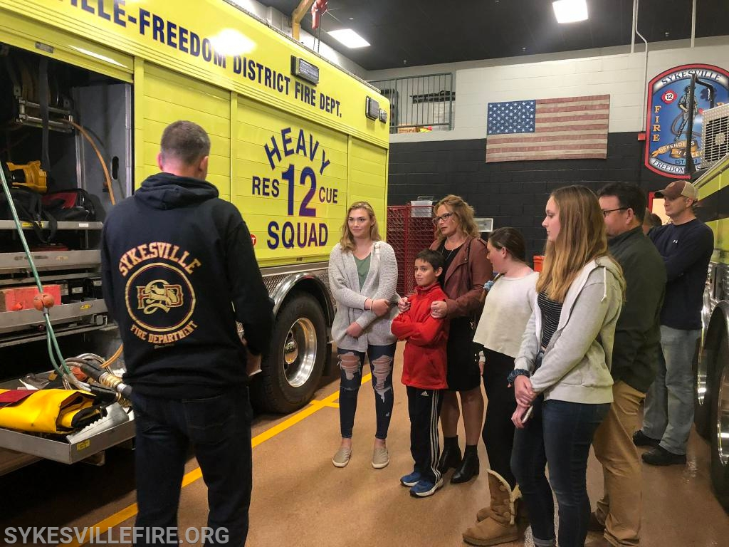 Chief Ruch shows the family the rescue squad, which responded to their crash scene on November 5, 2004.
