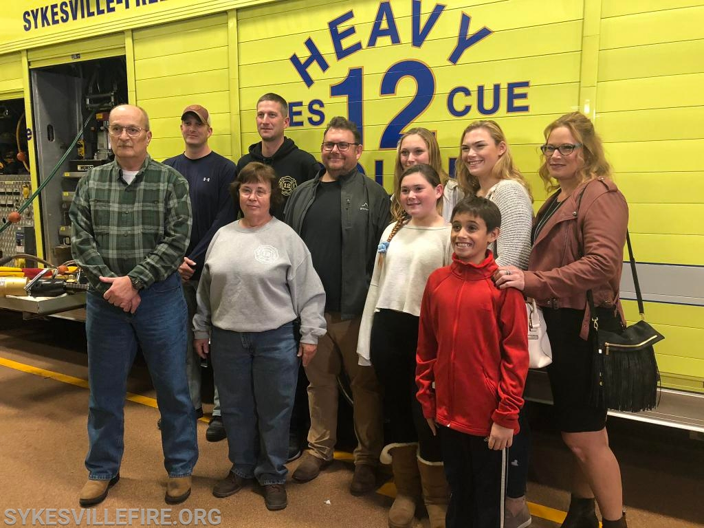 The Oberholzer family poses with some of the rescuers on hand 15 years ago, including Steve Bitzel, Brian Ruch, Chief Eddie Ruch, Jr., and Libby Luebberman.
