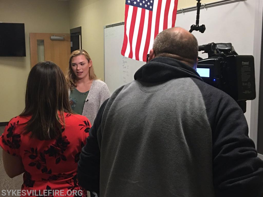 Erin Oberholzer is interviewed by WMAR-TV's Erin MacPherson