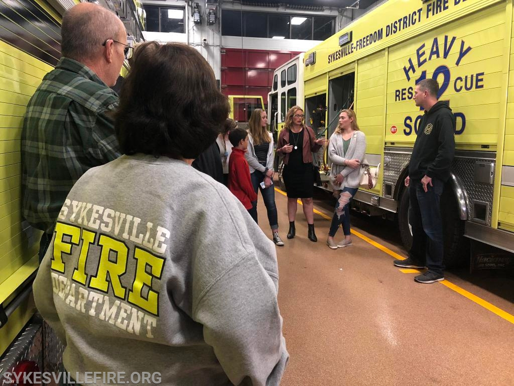 Chief Eddie Ruch, Jr. along with firefighters Steve Bitzel and Libby Luebberman, meet with the Oberholzer family.
